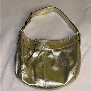Authentic metallic gold Coach shoulder purse